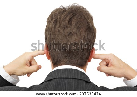 businessman blocking his ears with fingers .  deaf manager concept - stock photo