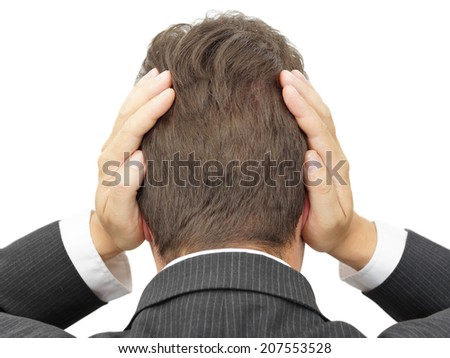 businessman blocking his ears with hands - stock photo