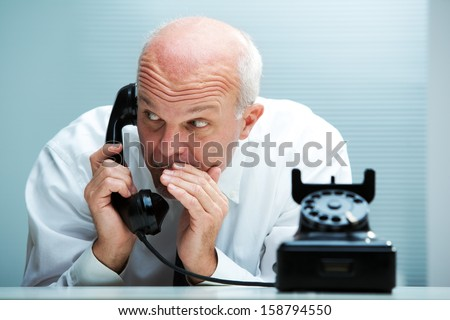 Businessman blurting by phone (focus on the man) - stock photo