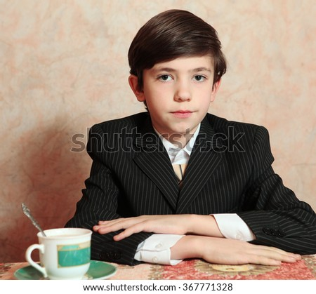 businessman  boy in black suit coffee sit at the table close up portrait - stock photo