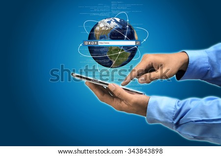 Businessman browsing the internet world to search for information - stock photo