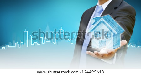 Businessman build your city concept - stock photo