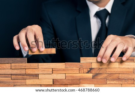 Businessman building the wall