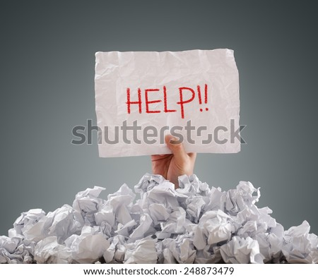 businessman buried under crumpled pile papers stock photo  businessman buried under crumpled pile of papers a help sign