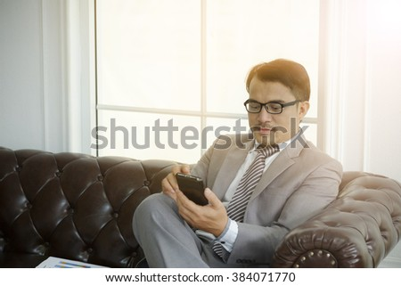 businessman busy with smartphone , business concept ,business idea ,business strategy - stock photo