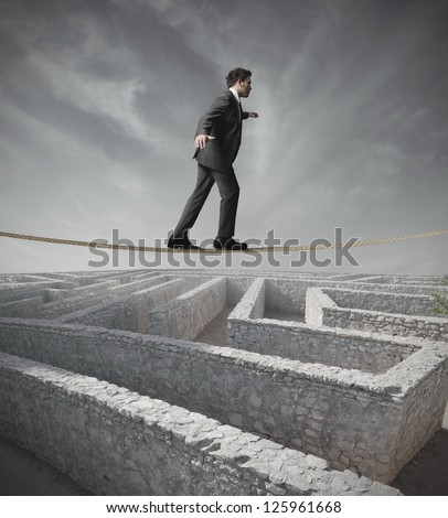 Businessman bypass the maze with the rope - stock photo