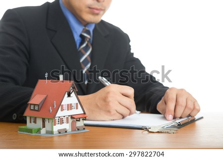 Businessman calculate and plan for your good property with real agency property. - stock photo