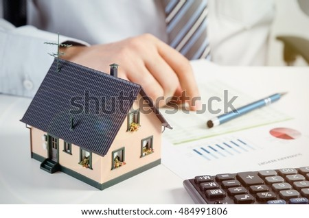 Beautiful Businessman Calculate The Cost Of Building And Maintaining House. Home  Finance Conception