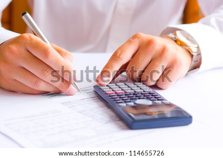 Businessman calculating financial results in the office