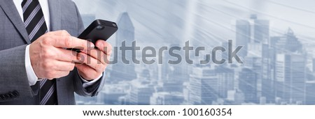 Businessman calling by phone. Technology background. - stock photo