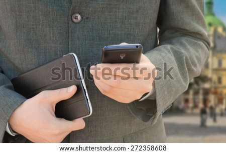 Businessman calls by telephone