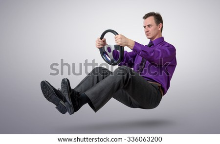 Businessman car driver with a steering wheel - stock photo