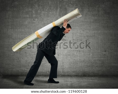 Businessman carries a stack of dollars - stock photo