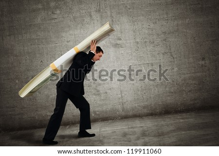 Businessman carries a stack of dollars