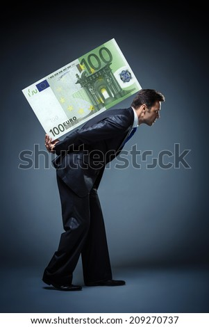 Businessman carries great euro
