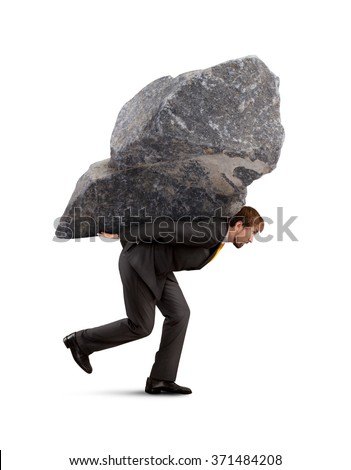 Businessman carry the rock on his back - stock photo