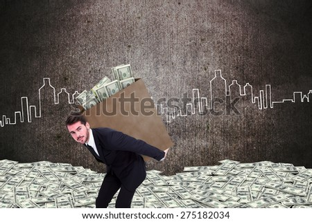 Businessman carrying bag of dollars against hand drawn city plan - stock photo