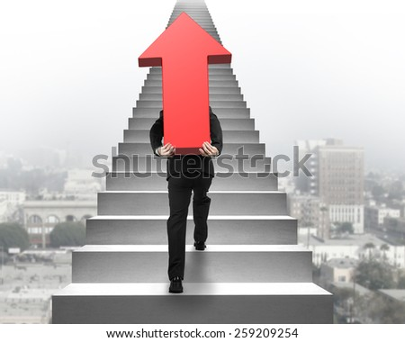 Businessman carrying big 3D red arrow sign and climbing on concrete stairs with urban scene background - stock photo