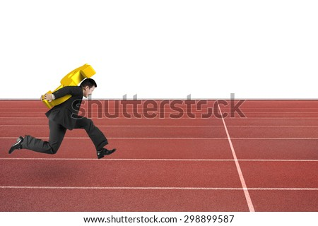 Businessman carrying 3D golden dollar sign running on red track, with white background.