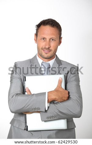 Businessman carrying laptop computer - stock photo