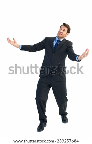 Businessman carrying something heavy with his hands on white background