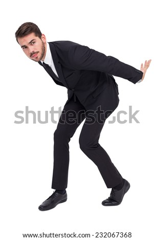 Businessman carrying something with his back and hands on white bakcground