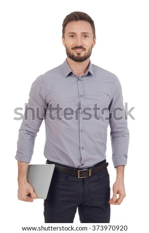 Businessman carying a digital tablet - stock photo