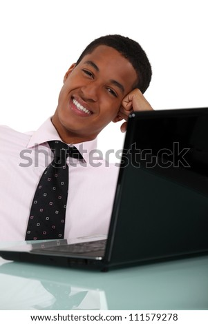 Businessman casually sat at desk - stock photo
