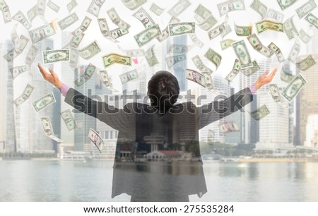 Businessman catching money with open arm with white background