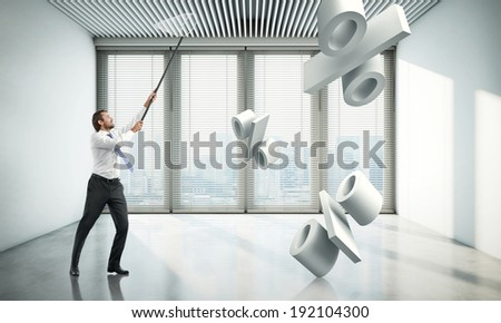 Businessman catching percentage signs - stock photo