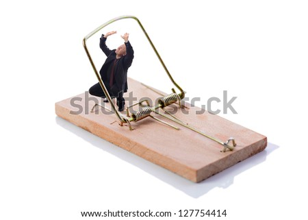 Businessman caught in a trap isolated on white - stock photo