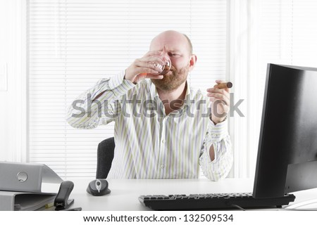 Businessman celebrate smoking and drinking in the office.