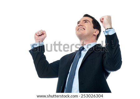 Businessman celebrating his success with raising arms - stock photo