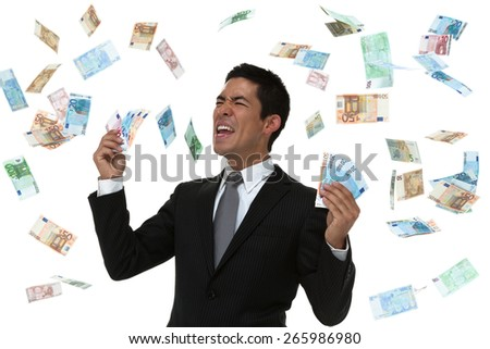 Businessman celebrating in a money rain storm. Concept. - stock photo