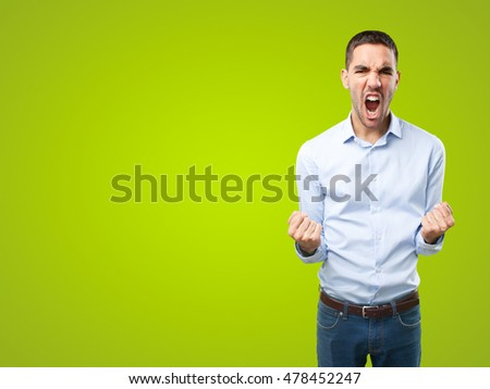 Businessman celebrating on green background