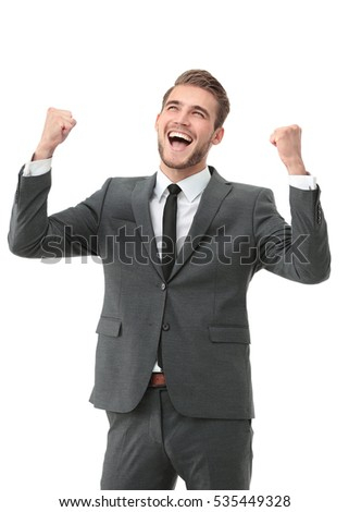 Businessman celebrating  with his fists raised in the air and a