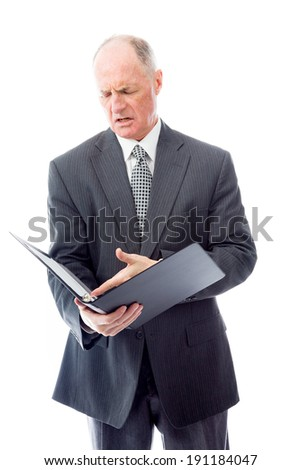 Businessman checking a file