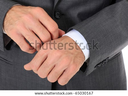 Businessman checking his clothes. All on white background - stock photo