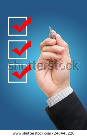 Businessman checking mark checklist marker Isolated on blue background - stock photo