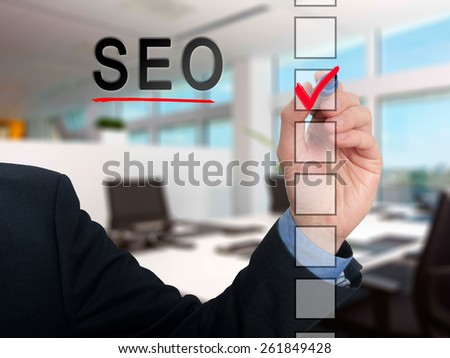 businessman checking  mark on  checklist marker. Checking SEO. Isolated on office background, Stock Photo  - stock photo