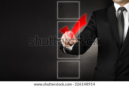Businessman checking one of four white coxes   - stock photo