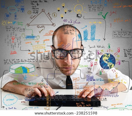 Businessman checking statistics and diagrams on pc - stock photo