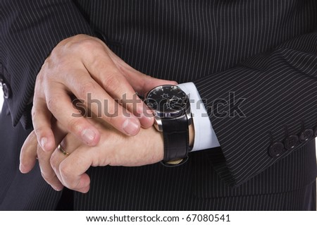 Businessman checking the time on his watch - stock photo