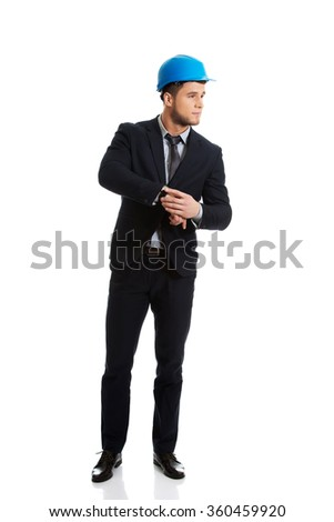 Businessman checking time on his wrist watch. - stock photo