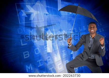 Businessman cheering and holding umbrella against blue departures board for american cities - stock photo