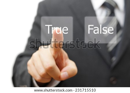businessman choose virtual button with true word instead false - stock photo