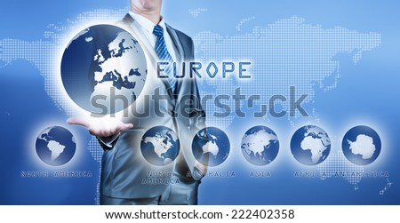 Businessman choosing europe continent on virtual digital screen, business concept of decision making - stock photo