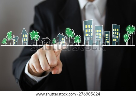 Businessman choosing house, real estate concept. Hand pressing the house icon. Copy space. - stock photo