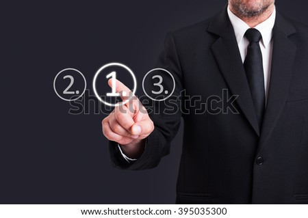 Businessman choosing number one digital button from touchscreen as high-tech access combination concept - stock photo