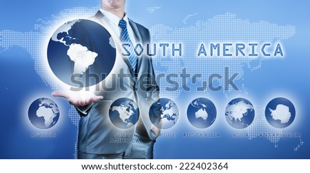 Businessman choosing south america continent on virtual digital screen, business concept of decision making - stock photo